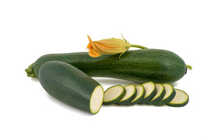 green fresh zucchini isolated on white background